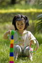 Girl playing quoits Royalty Free Stock Photos