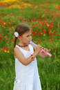 Girl playing a recorder (flute) Royalty Free Stock Image
