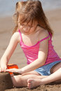 Girl playing with sand Royalty Free Stock Photo