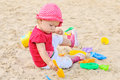 Girl playing in sand baby Royalty Free Stock Photos