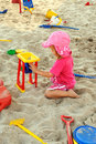 Girl playing in sand pit Royalty Free Stock Images
