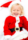 Girl playing santa little and looking very happy Stock Photos