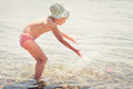 Girl playing in the sea little Royalty Free Stock Images