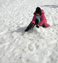 Girl playing in snow Royalty Free Stock Photos