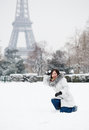 Girl playing snowballs near the Eiffel tower in Paris Royalty Free Stock Photo