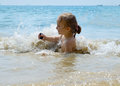 Girl playing in surf years old baby water at ao nang beach thailand Stock Photos