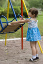 Girl playing with swing Royalty Free Stock Photo