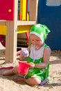 The girl playing to a sandbox Stock Images