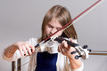 Girl playing violin Royalty Free Stock Photo