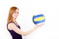 Girl playing volleyball with ball Royalty Free Stock Photography