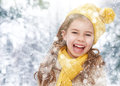 Girl playing on a winter walk happy child in nature Royalty Free Stock Photo