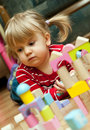 Girl playing with wood blocks Stock Images