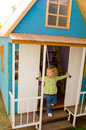 Girl playing in wooden playhouse Stock Images