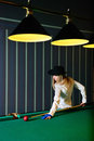 image photo : The girl plays billiards
