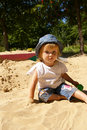 Girl plays sand on a garden Stock Image