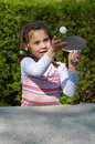 Girl plays table tennis little playing in the park Stock Images