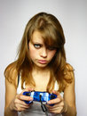 Girl plays video game Royalty Free Stock Photo