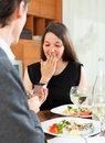 Girl pleasantly surprised gift from man men on date Stock Photography