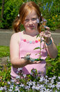 Girl is plucking flowers Stock Photo