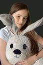 Girl and plush animal Royalty Free Stock Photo