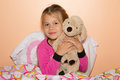 Girl and plush dog cute little is getting ready to get to bed hugging a Royalty Free Stock Image