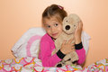 Girl and plush dog cute little is getting ready to get to bed hugging a Stock Photography