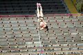 Girl on the pole vault competition Royalty Free Stock Images