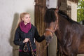 Girl with pony is holding brown new forest on a leash Stock Images