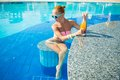 Girl in pool bar at tropical tourist resort vacation destination Stock Image
