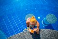 Girl in pool bar at tropical tourist resort vacation destination Royalty Free Stock Photography