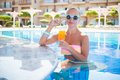 Girl in pool bar at tropical tourist resort vacation destination Stock Photography