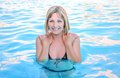 Girl in the pool a bathing suit floating Stock Image