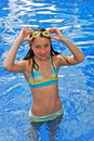 Girl in pool with goggles Stock Photo