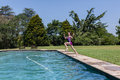 Girl Pool Jumping Royalty Free Stock Photo