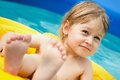 Girl in the pool little swimming Royalty Free Stock Photo