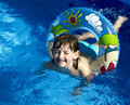 Girl in pool young the with life buoy Stock Photography