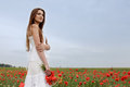 Girl in poppies field Royalty Free Stock Images