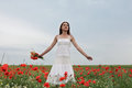 Girl in poppies field Stock Photography