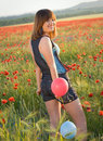 Girl in poppy field Stock Images