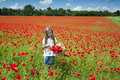Girl on a poppy field Royalty Free Stock Photos