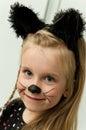 Girl posing as a kitten Royalty Free Stock Photo