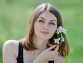 Girl posing with flower of apple outdoors portrait attractive young woman on open air Stock Photo