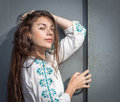 Girl posing near door young woman old metal Stock Photos