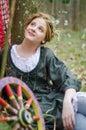 Girl posing near vintage wheel Royalty Free Stock Photo