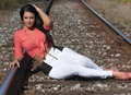 Girl posing on the railroad picture of beautiful young woman Stock Photos
