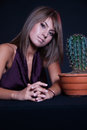 Girl posing in studio with cactus Royalty Free Stock Photo