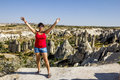 Girl posing on top of a cliff in Cappadocia, Turkey