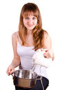Girl and a pot is mixing her Royalty Free Stock Photos