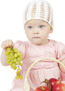 Girl with pottle of fruit Stock Images