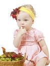 Girl with pottle of fruit Royalty Free Stock Images